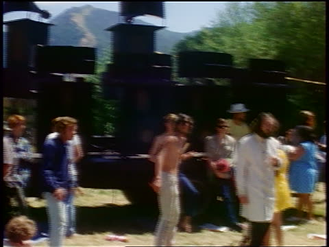vídeos de stock e filmes b-roll de 1968 group of hippies dancing near stage at outdoor concert / tapia park california / newsreel - love in