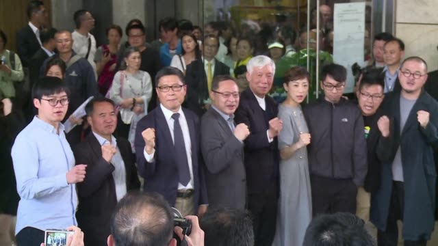 vídeos y material grabado en eventos de stock de a group of hong kong activists face jail after being convicted on colonial era public nuisance charges for their role in organising mass pro... - noreste de china