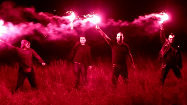 group of hooligans holding torches at night - flaming torch stock videos & royalty-free footage