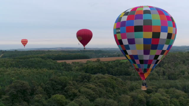 group of hot air balloons over english countryside - small group of objects stock videos & royalty-free footage