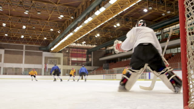 Group of ice hockey players in action during the match at ice hockey arena.