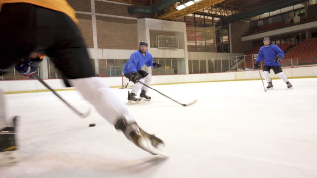 group of ice hockey players in action on a sports match in ice hockey rink. - tackling stock videos and b-roll footage