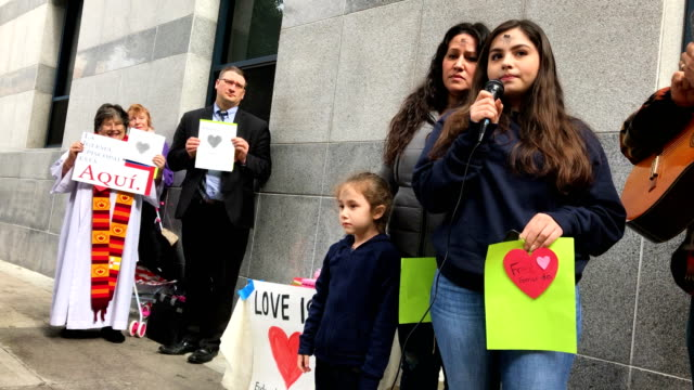 a group of immigration activists and faith leaders stage a valentine's day demonstration outside of the office of the immigration and customs... - deportation stock videos and b-roll footage