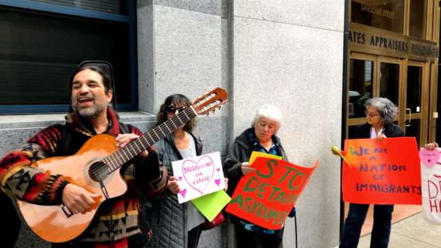 a group of immigration activists and faith leaders stage a valentine's day demonstration outside of the office of the immigration and customs... - sanctuary city stock videos & royalty-free footage