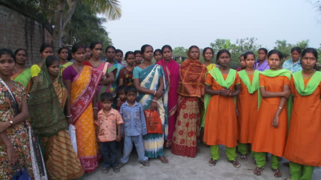 Group of Indian women and children standing in a group