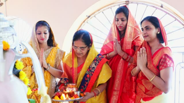 group of indian women praying at the temple - traditional clothing stock videos & royalty-free footage