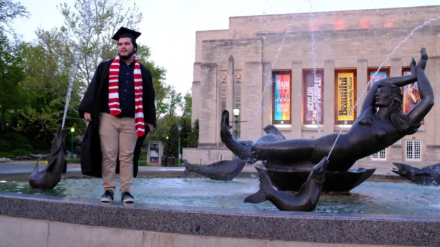 group of indiana university students who just finished graduating from the kelley school of business during a video ceremony this weekend celebrate... - jumping stock videos & royalty-free footage
