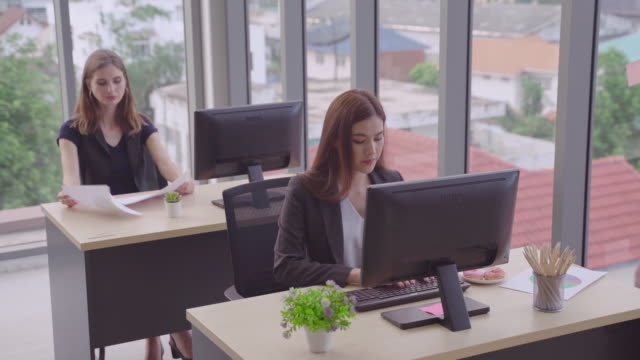 group of international business travelers are working in the office, ethnically diverse business and are talking to or meeting with business partners about a star up in the meeting.concepts, business team partners - accountancy stock videos & royalty-free footage