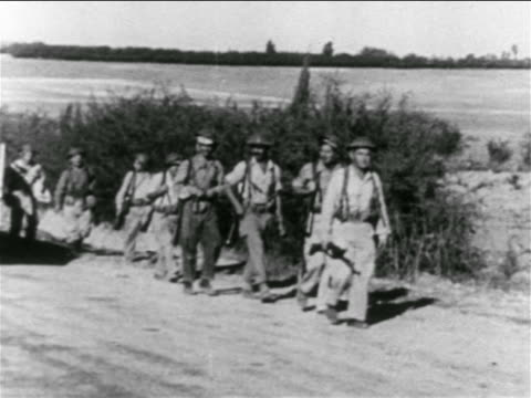 b/w 1956 group of israeli soldiers walking on country road / suez crisis / middle east - israeli military stock videos and b-roll footage