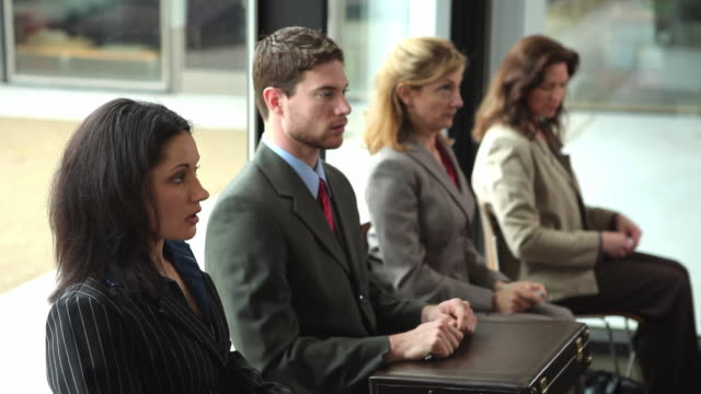 ms group of job applicants waiting to be called into meeting / portland, oregon, usa - job interview stock videos & royalty-free footage