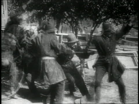 b/w 1914 group of keystone kops jumping + running offscreen away from something / feature - 1914 stock videos & royalty-free footage