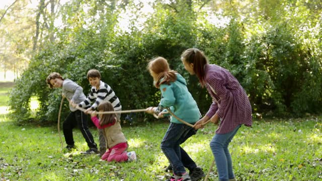 group of kids in a tug-of-war game - pulling stock videos & royalty-free footage