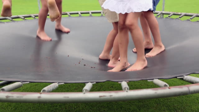 Group of kids jumping on the Trampoline