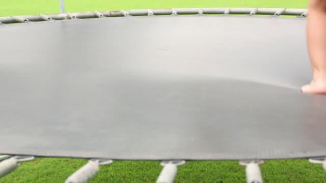group of kids jumping on the trampoline - pedana elastica per saltare video stock e b–roll