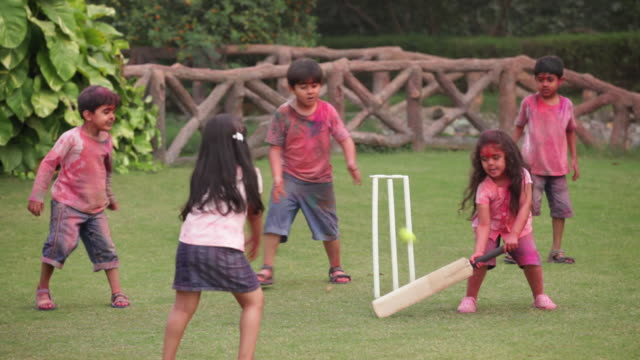 group of kids playing cricket in holi festival  - cricket stock videos & royalty-free footage