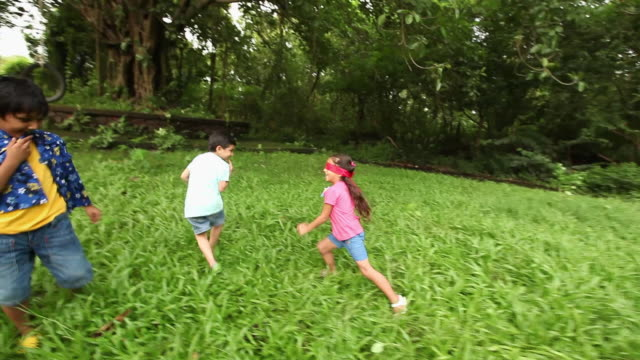 group of kids playing in a park  - blindfold stock videos and b-roll footage