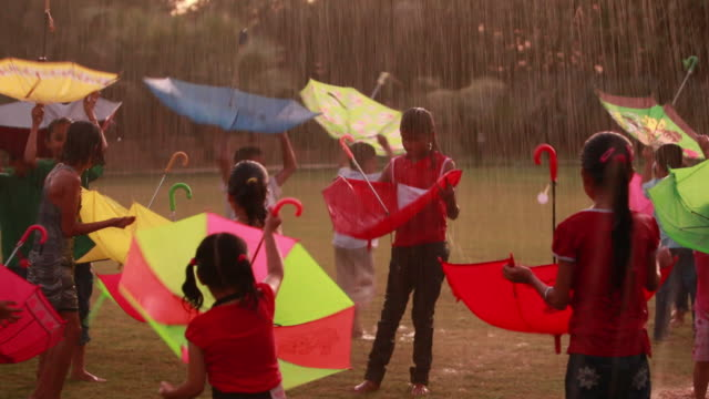 Group of kids playing in the rain