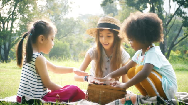 group of kids relaxing in garden. - natural parkland stock videos & royalty-free footage