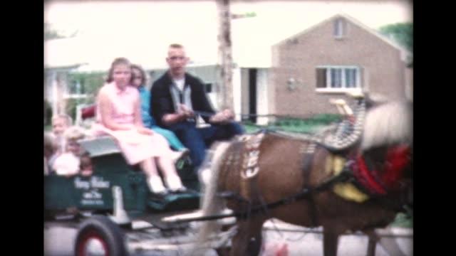 1960 group of kids riding in horse cart - fahrzeug fahren stock-videos und b-roll-filmmaterial