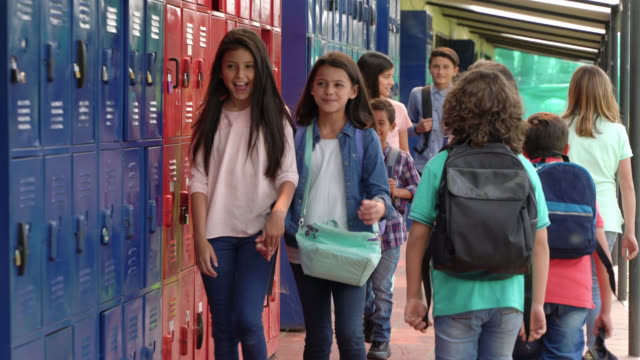 group of kids walking to class at school - education concepts - first day of school stock videos & royalty-free footage