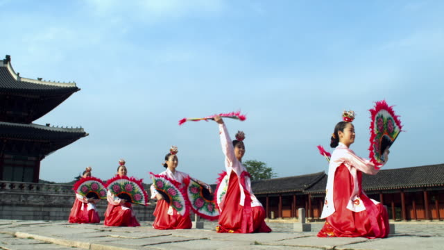 ms group of korean fan dance group performing behind gyeongbokgung palace / seoul, south korea  - hand fan stock videos and b-roll footage