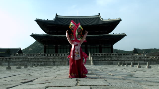 MS ZI Group of Korean fan dance group performing behind Gyeongbokgung Palace / Seoul, South Korea