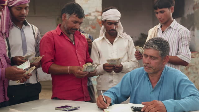 group of labours counting indian rupees, haryana, india - authority stock videos & royalty-free footage