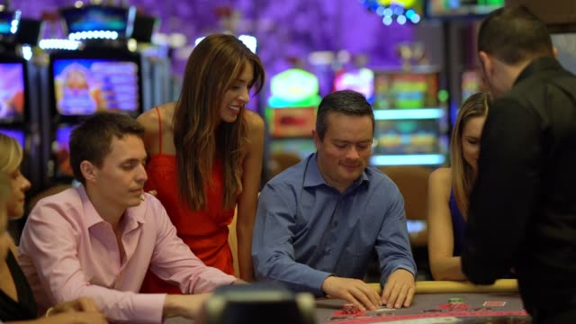 group of latin american players at the blackjack table looking focused - blackjack stock videos and b-roll footage