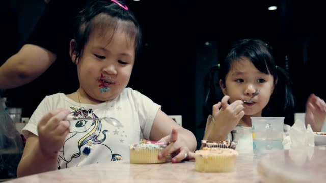 group of little girls enjoying the birthday cake - muffin stock videos and b-roll footage
