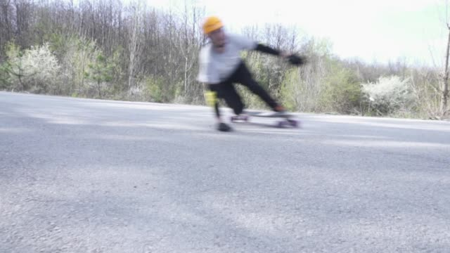 group of longboarders passing really fast - longboarding stock videos & royalty-free footage