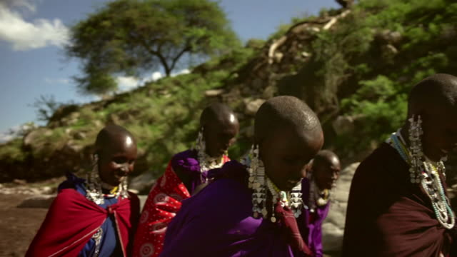 a group of maasai women collects ochre for a ceremony - indigenous culture stock videos & royalty-free footage