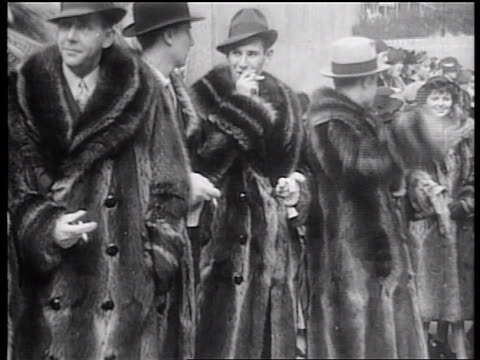 B/W 1936 group of male models posing with fur coats + smoking / Rockefeller Center, NYC