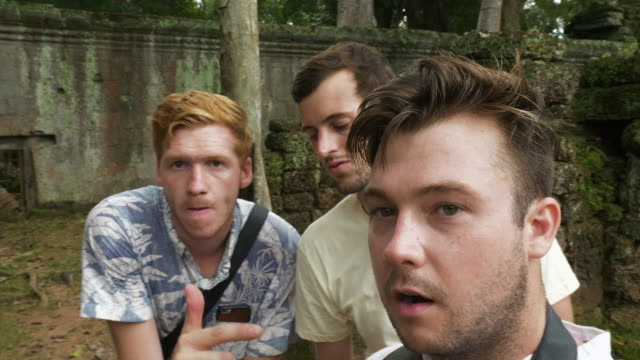 Group of Male Tourists Vlogging their Tour in Cambodian Ruins