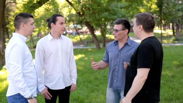 Group of males in park talking