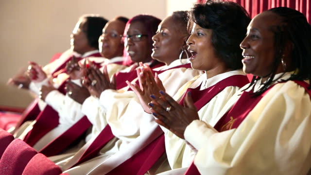 Group of mature black women singing in church choir
