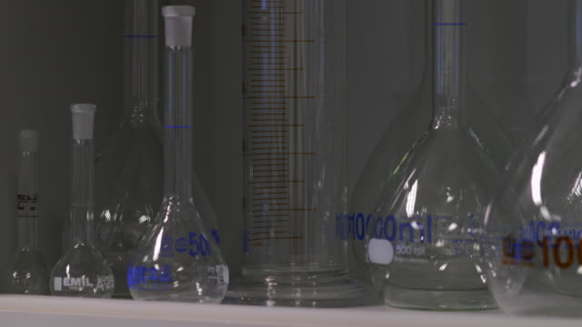 group of measuring cylinders - cylinder stock videos & royalty-free footage