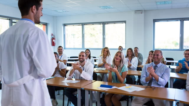 ms group of medical students, doctors and nurses at healthcare lecture - medical student stock videos and b-roll footage