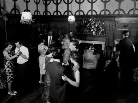 a group of men and women attempt to dance the waltz in a wood panelled room 1963 - couple relationship stock videos & royalty-free footage
