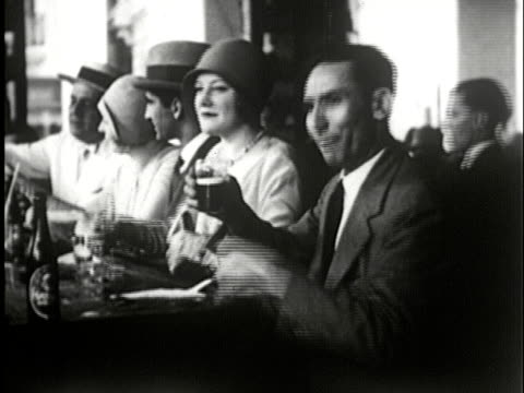 ms, b/w, group of men and women drinking and laughing sitting at bar, havana, cuba - prelinger archive stock-videos und b-roll-filmmaterial