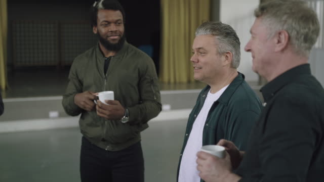 Group of men chat during coffee break