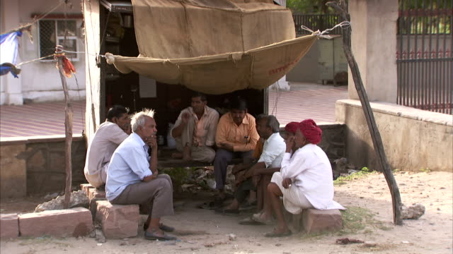 A group of men chatting under a shade, Jaipur, India Available in HD