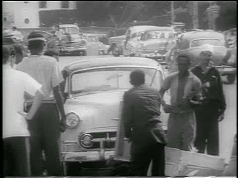vidéos et rushes de b/w 1959 group of men destroying furniture in street after revolution / havana / newsreel - révolution cubaine