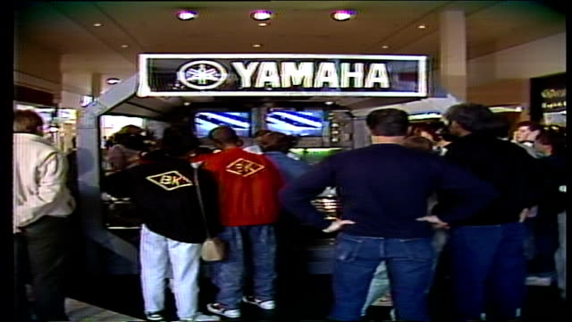 Group of Men in Front of Yamaha Display and Demo