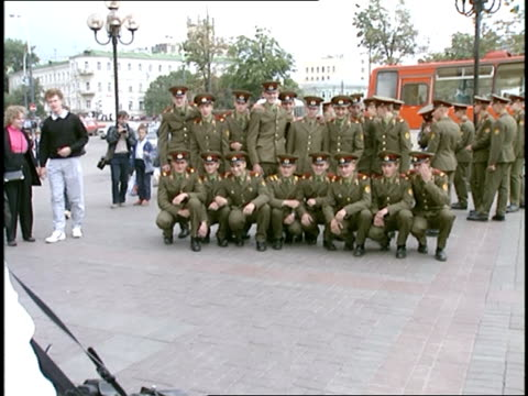 Group of Men in Russian Uniform Posing For Photo in Moscow