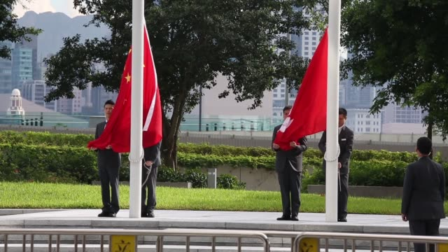 group of men in suits march onto stage for a flag-raising ceremony outside the legislative council complex in hong kong, china, on thursday, july 11... - hong kong flag stock videos & royalty-free footage