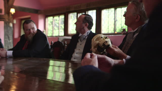 group meeting about skull in a historical reenactment - raw footage stock videos & royalty-free footage