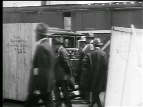 b/w 1927 group of men inspecting car in giant crate outdoors / new york state - 1927 stock videos & royalty-free footage