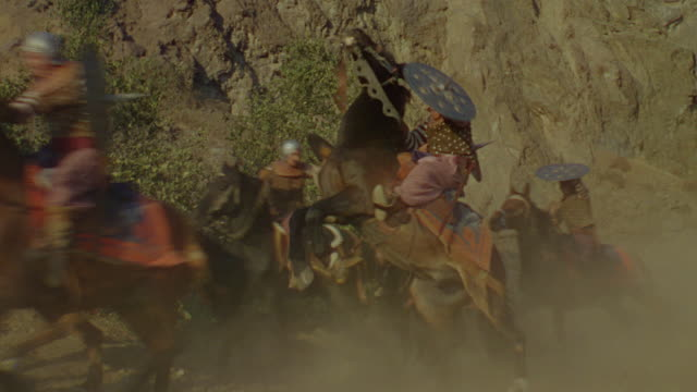 ms group of men on horseback shield themselves from rock barrage - historical reenactment stock videos & royalty-free footage