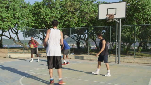 WS A group of men play basketball together / Rio de Janeiro, Brazil