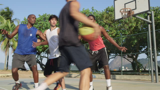 ws a group of men play basketball together / rio de janeiro, brazil - shooting baskets stock videos and b-roll footage